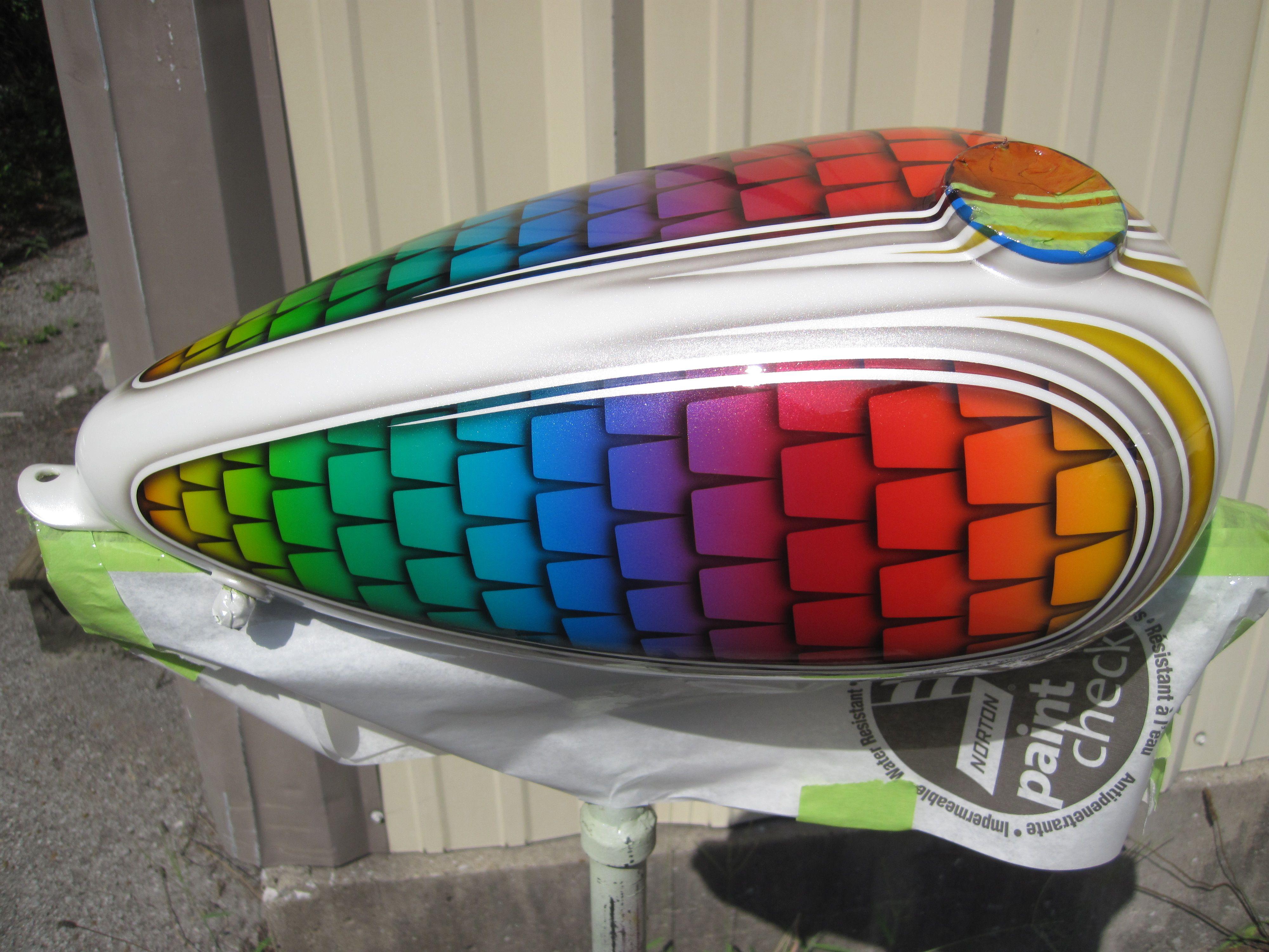 Custom rainbow fish scale paint job for chopper gas tank
