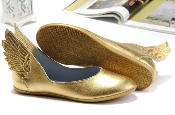 gold winged shoes