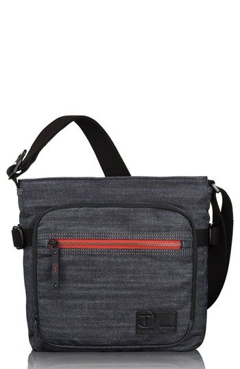 Dialed-in style defines a utilitarian crossbody bag cast in well-textured cotton and designed for all-day productivity. Color(s): denim, kha...