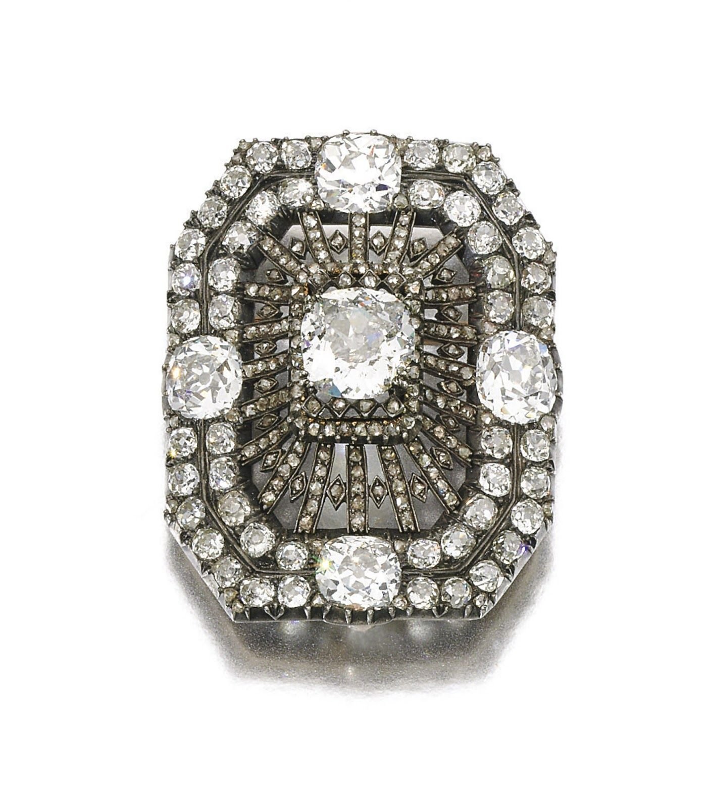DIAMOND BROOCH, MID 19TH CENTURY The octagonal open work plaque set with cushion-shaped, circular-cut and rose diamonds, later brooch fitting. 15,625 GBP