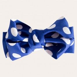 White polka dots lend a playful touch to a blue bow tie hair clip that's perfect for adding pizzazz to your up do and topping off your tresses in girlish glam, signature style.