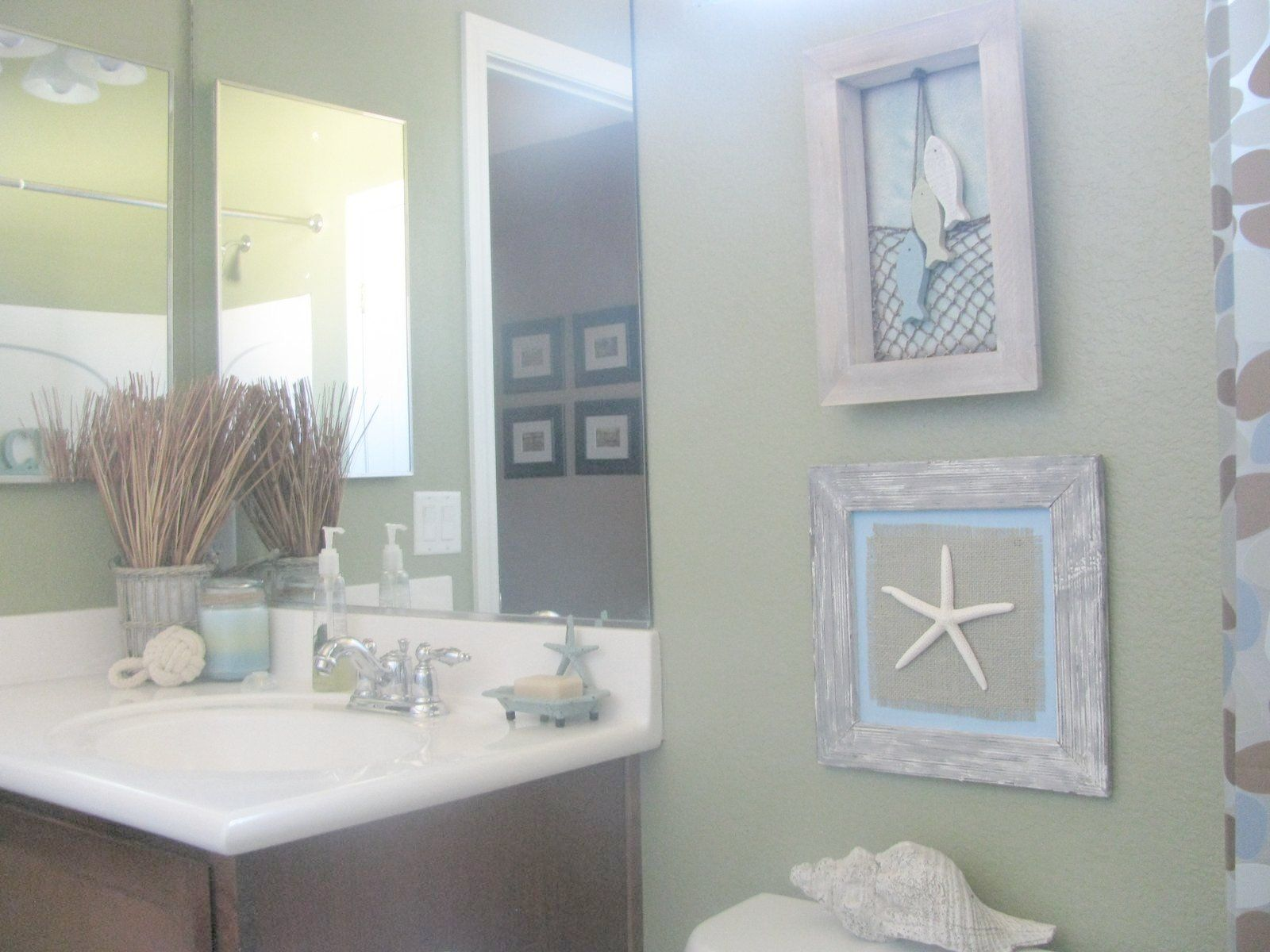 sand colored bathroom with light color (sea glass green) accents