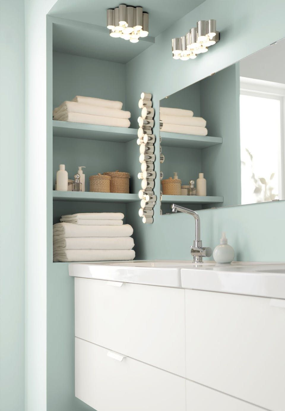 Bright bathroom with white bathroom furniture, mint-coloured walls ...