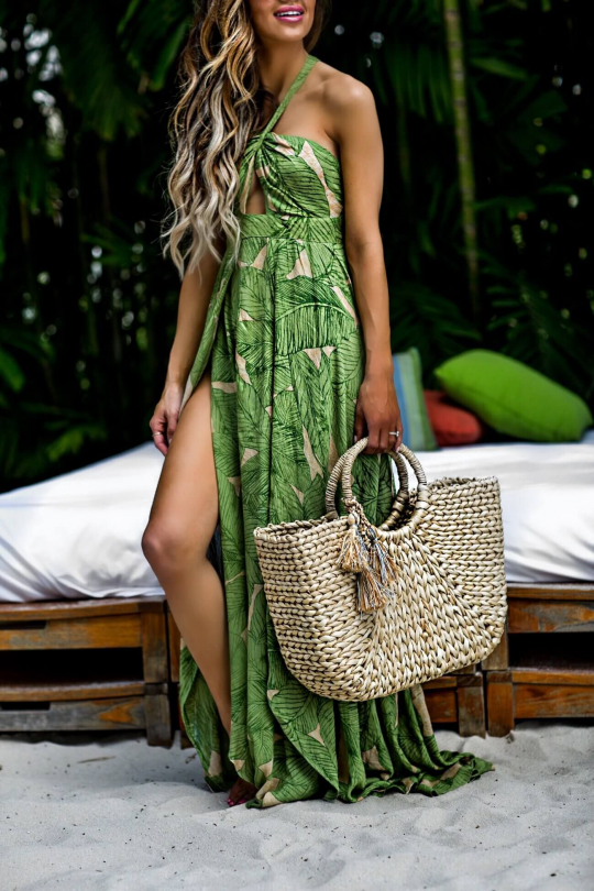 fashion blogger mia mia mine wearing a palm print dress from urban outffiters and a straw tote at the modern hotel in honolulu hawaii #hawaii #hawaii #outfits