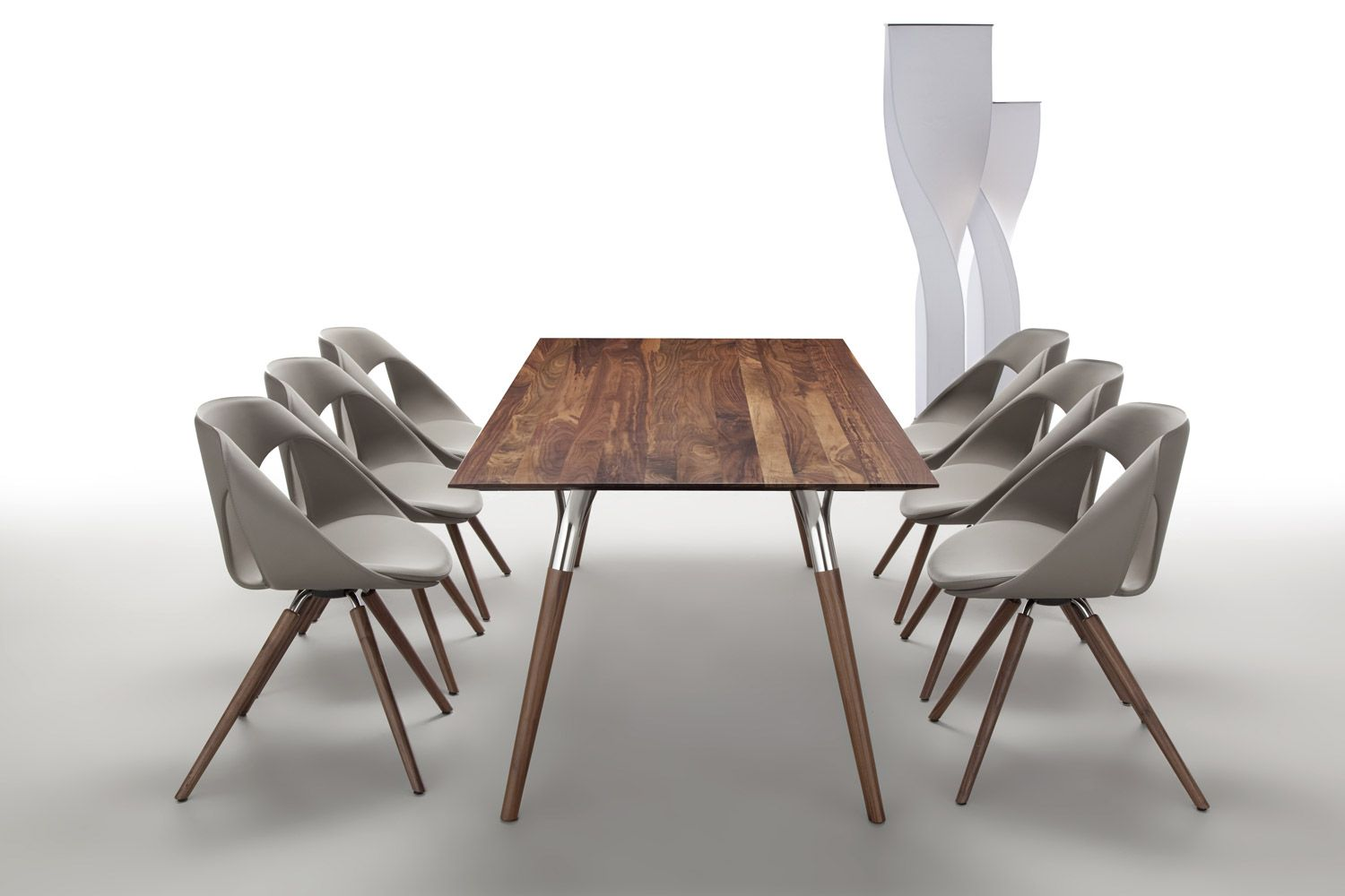Side Chairs With Seats In Leather Upholstery And Legs In Oak