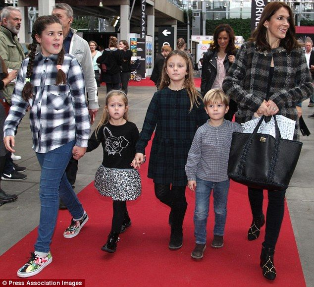 Family fun day: Princess Mary attended the annual Copenhagen Book Fair at the Bella Center on Saturday with her twins Prince Vincent and Princess Josephine, four, and eldest daughter Princess Isabella, eight