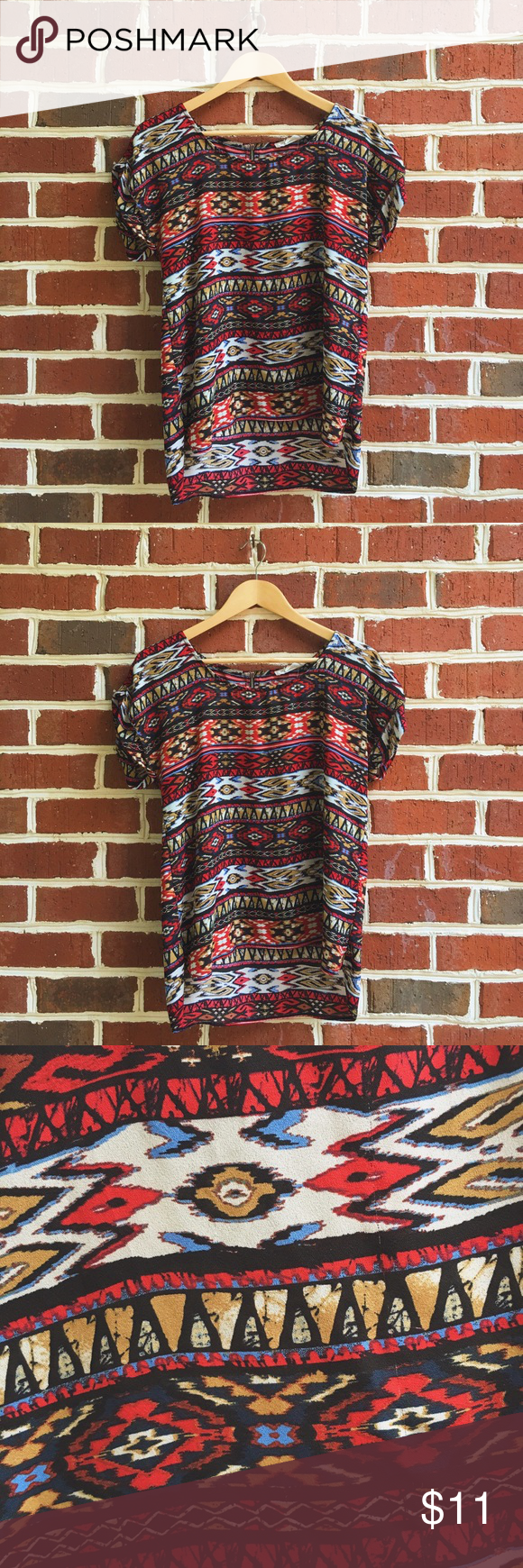 High-Low Aztec Blouse Aztec/Tribal patterned blouse with a high-low cut. Comfy, loose, and boxy fitting blouse with cuffed sleeves and a scoop neck. The back features a black and gold zipper which definitely gives it an edgy factor! Lastly, it especially looks great paired with white jeans! Pink Rose Tops Blouses