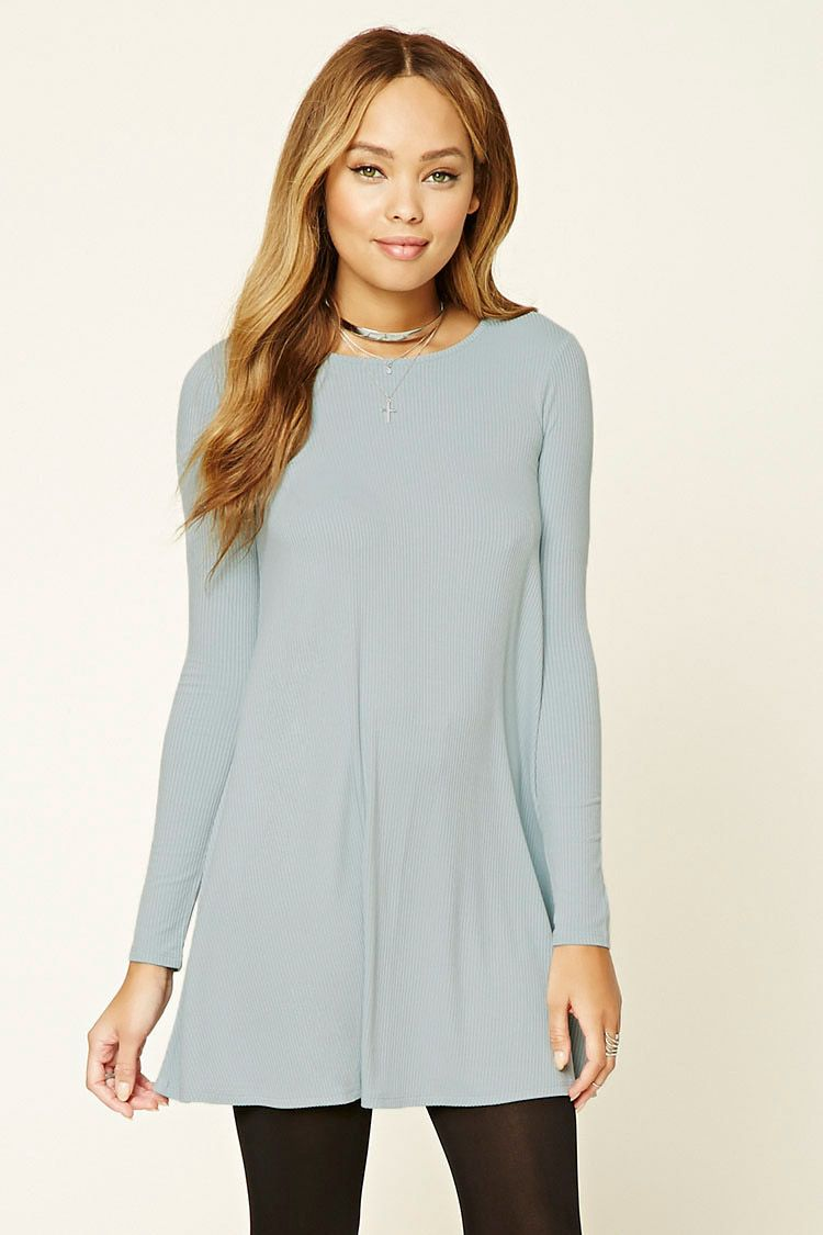 A ribbed knit dress featuring a swing silhouette a round neckline