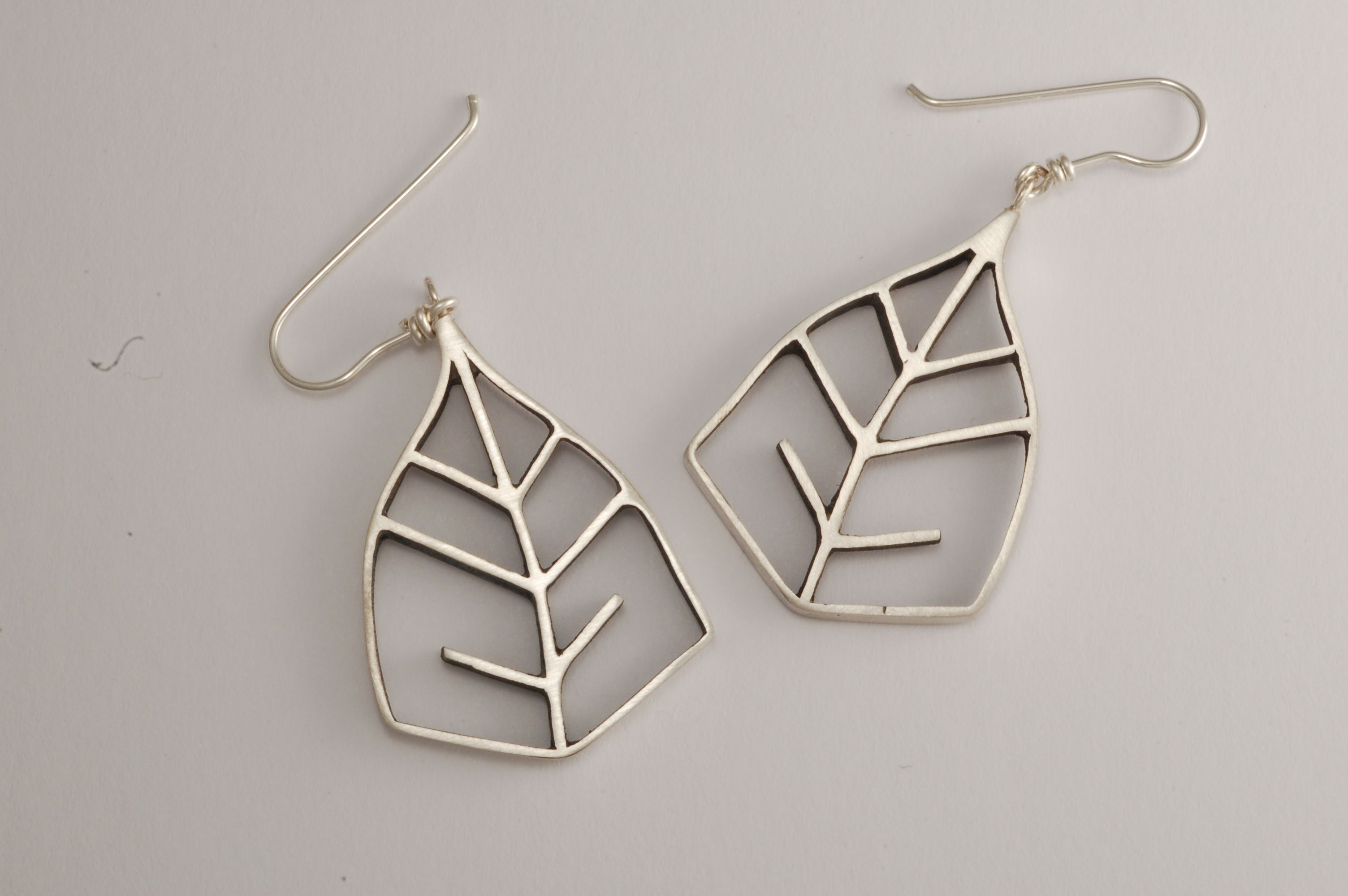 Handcrafted sterling silver paper birch leaf drop earrings $120 at andreamueller.ca.