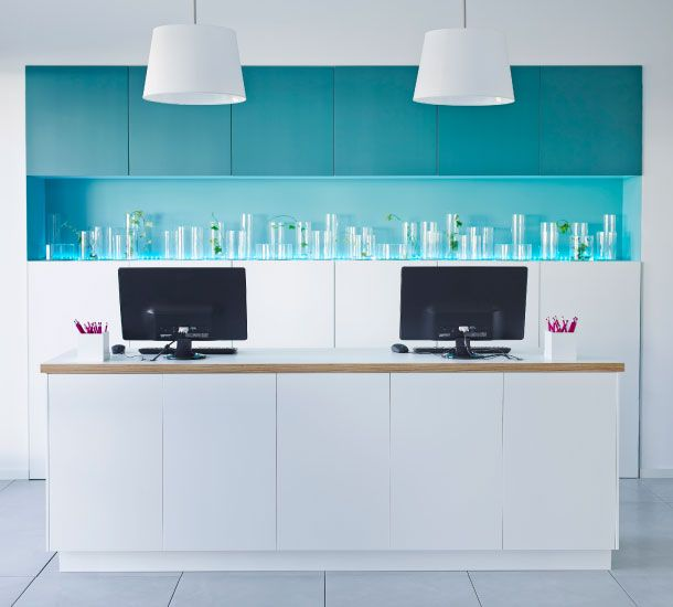 office kitchen Wall cabinets with grey-turquoise doors and base cabinets  with white doors