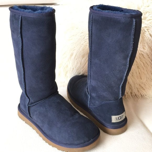 """UGG Navy suede tall winter boots UGG Navy suede tall winter boots   These have hardly been worn and are in excellent condition. Gently loved.  They measure 13"""" tall aprox. Can be rolled down or left up. Cozy and stylish.  As always Authentic !! UGG Shoes Winter & Rain Boots"""
