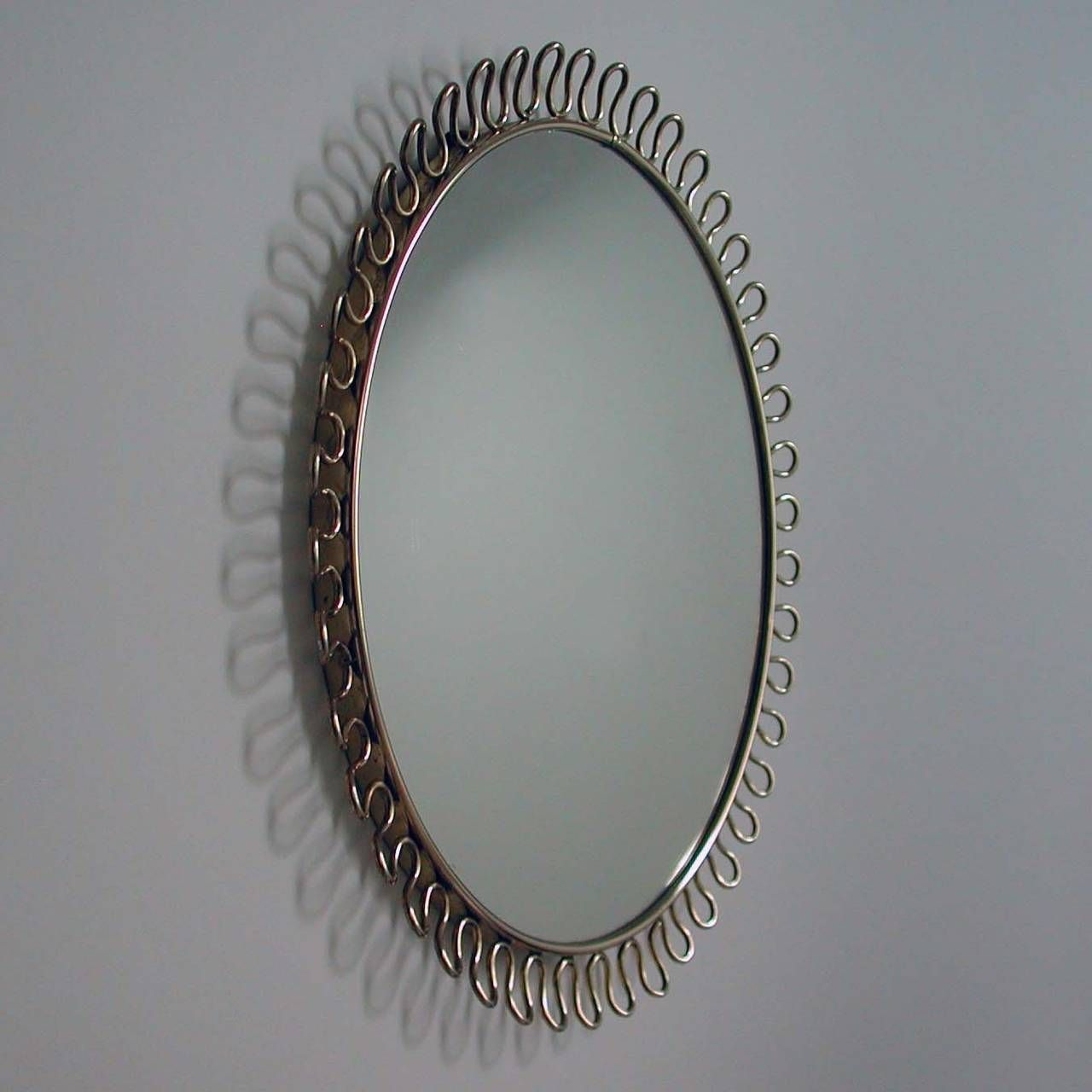 Petite sculptural brass loop mirror attr to josef frank Petit miroir decoratif