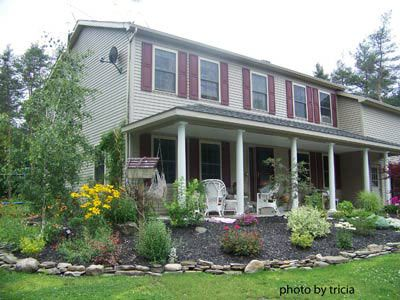Landscaping Ideas For Front Yard Ranch House With A Porch To Accommodate Slope