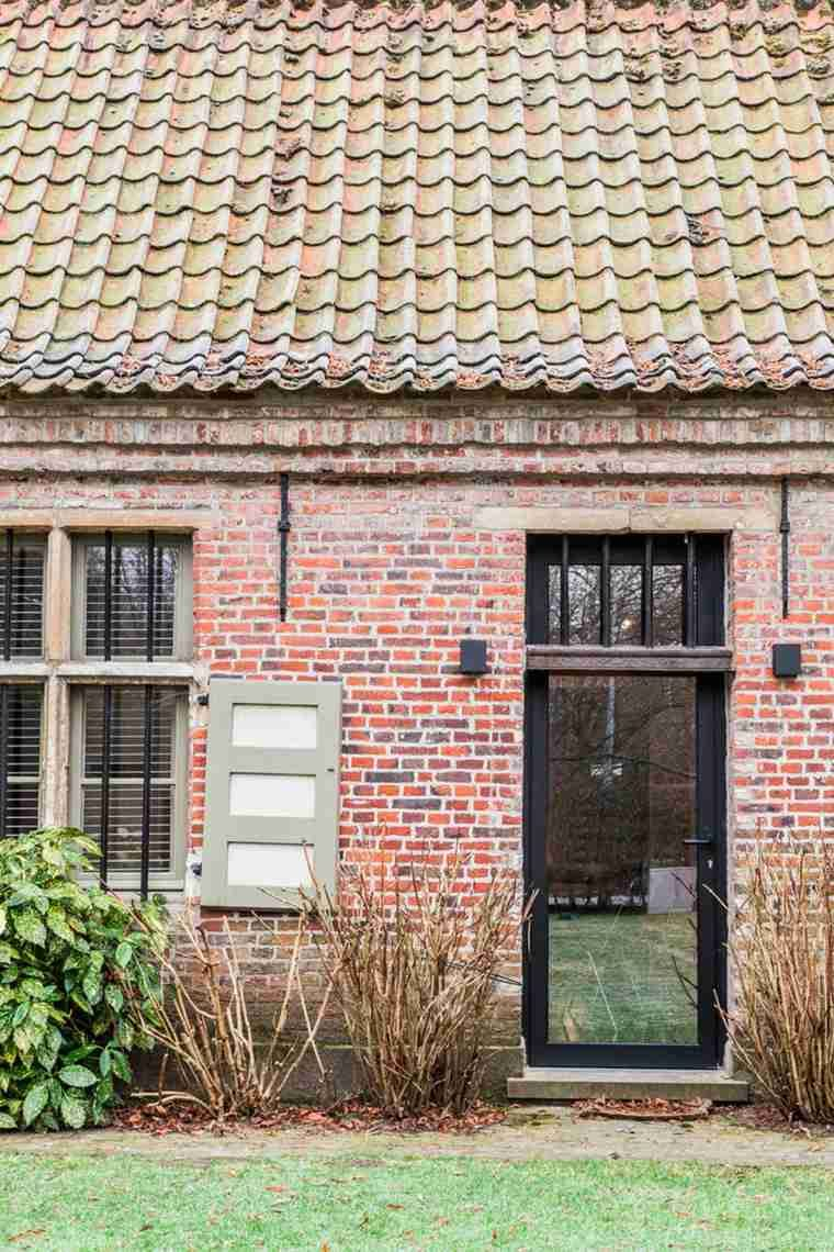Old brick farmhouse transformed into a modern and design