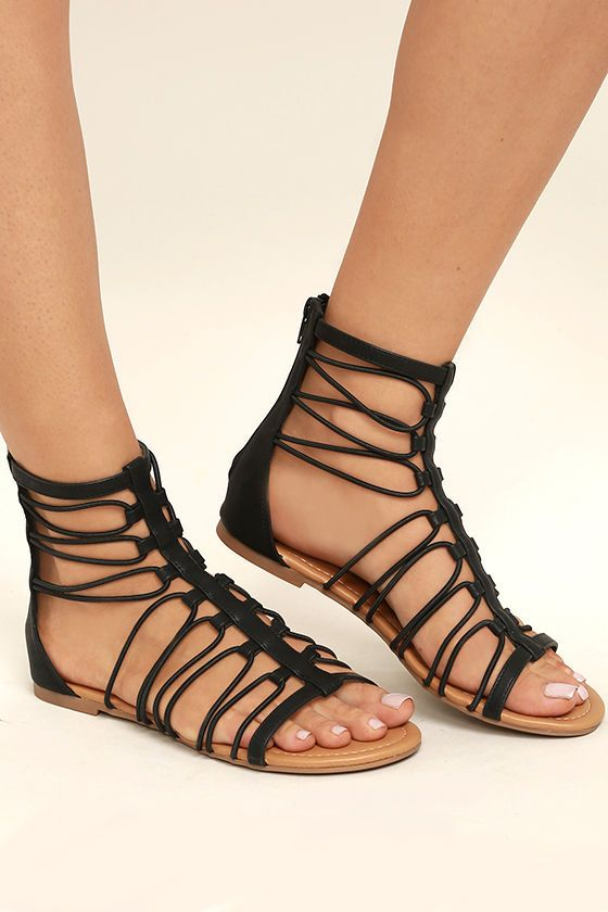 4f091caf71e1 Black vegan leather straps loop atop a peep-toe upper to a cute