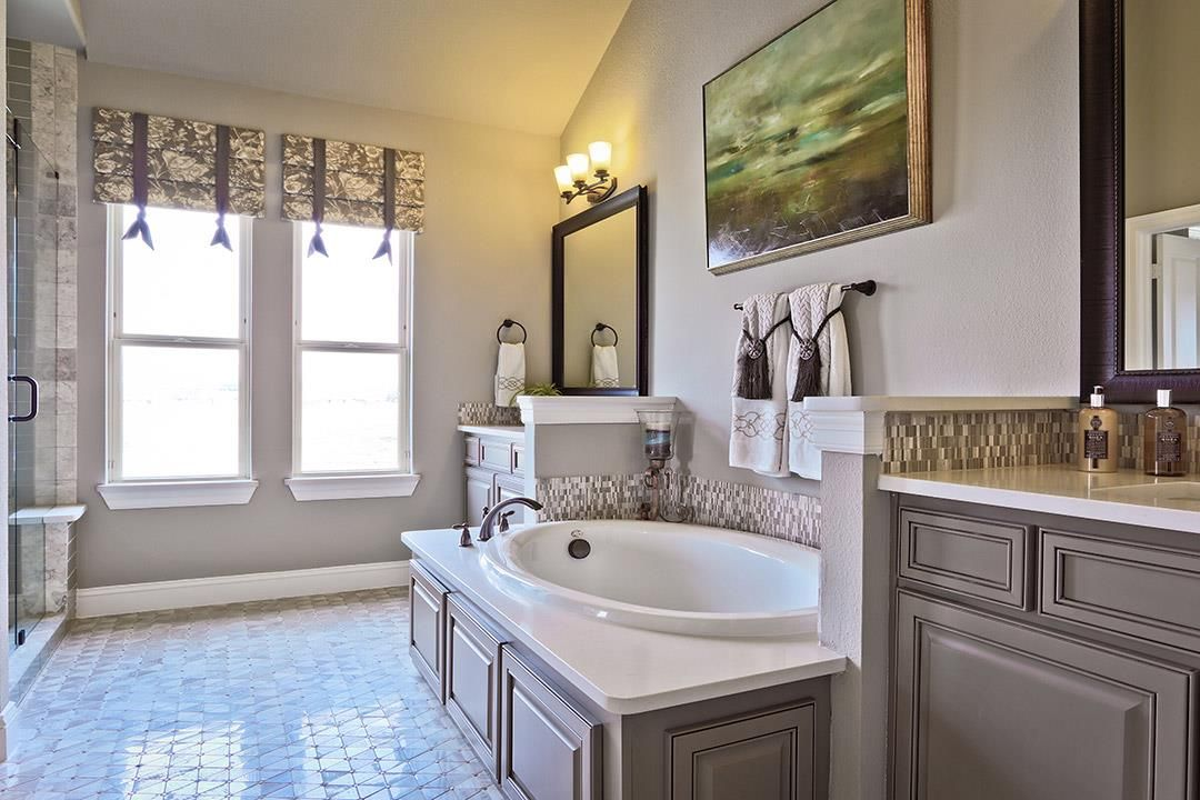 enjoy a bubblebath in this relaxing owners bathroom new homes in plano tx - Bathroom Cabinets Fort Worth Tx