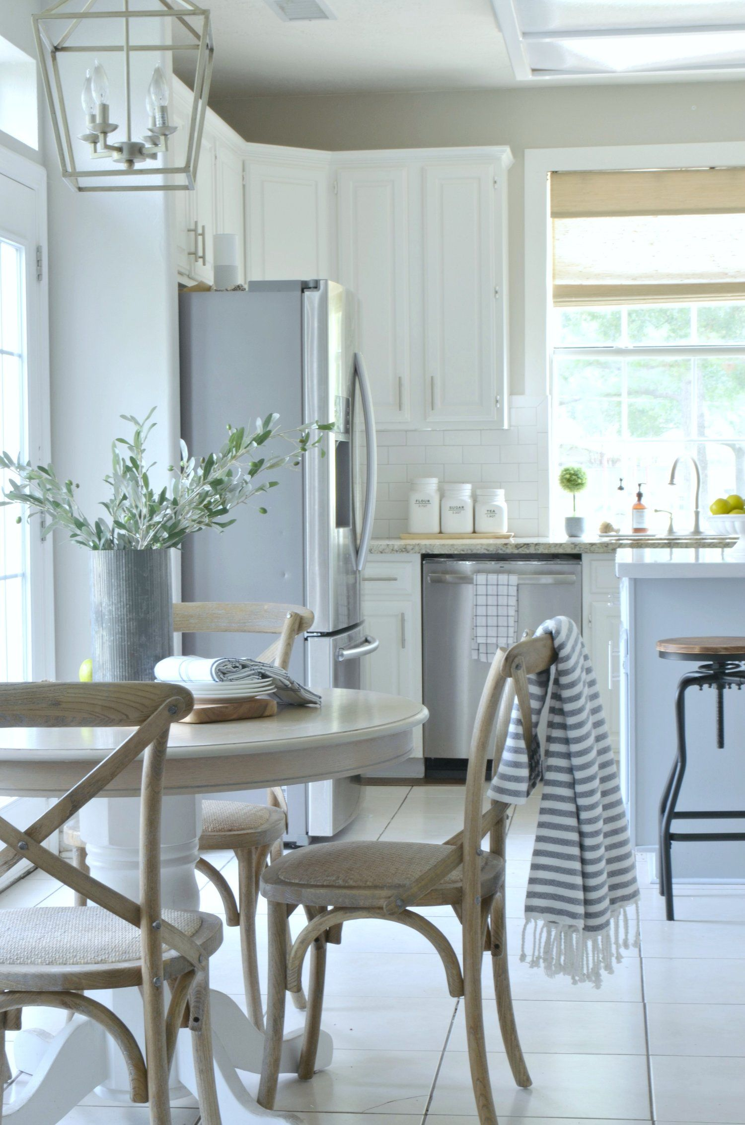 Farmhouse-style dining chairs give the breakfast nook an instant ...