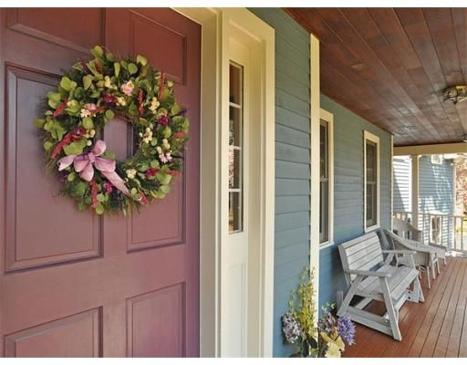 Welcoming porch with great door and wood ceiling