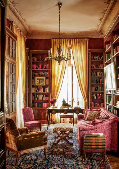 In the library the sofa is upholstered in a cotton damask the armchair is covered in a silk velvet and the slipper chair is