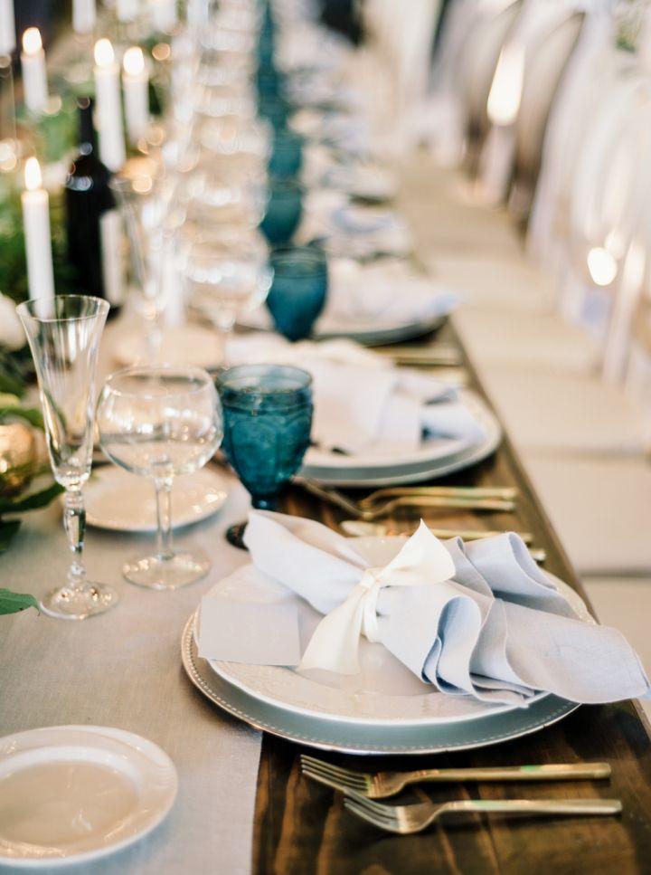 Beautiful wedding tablescape + greenery + blue vintage glassware #bluewedding #weddingdetails