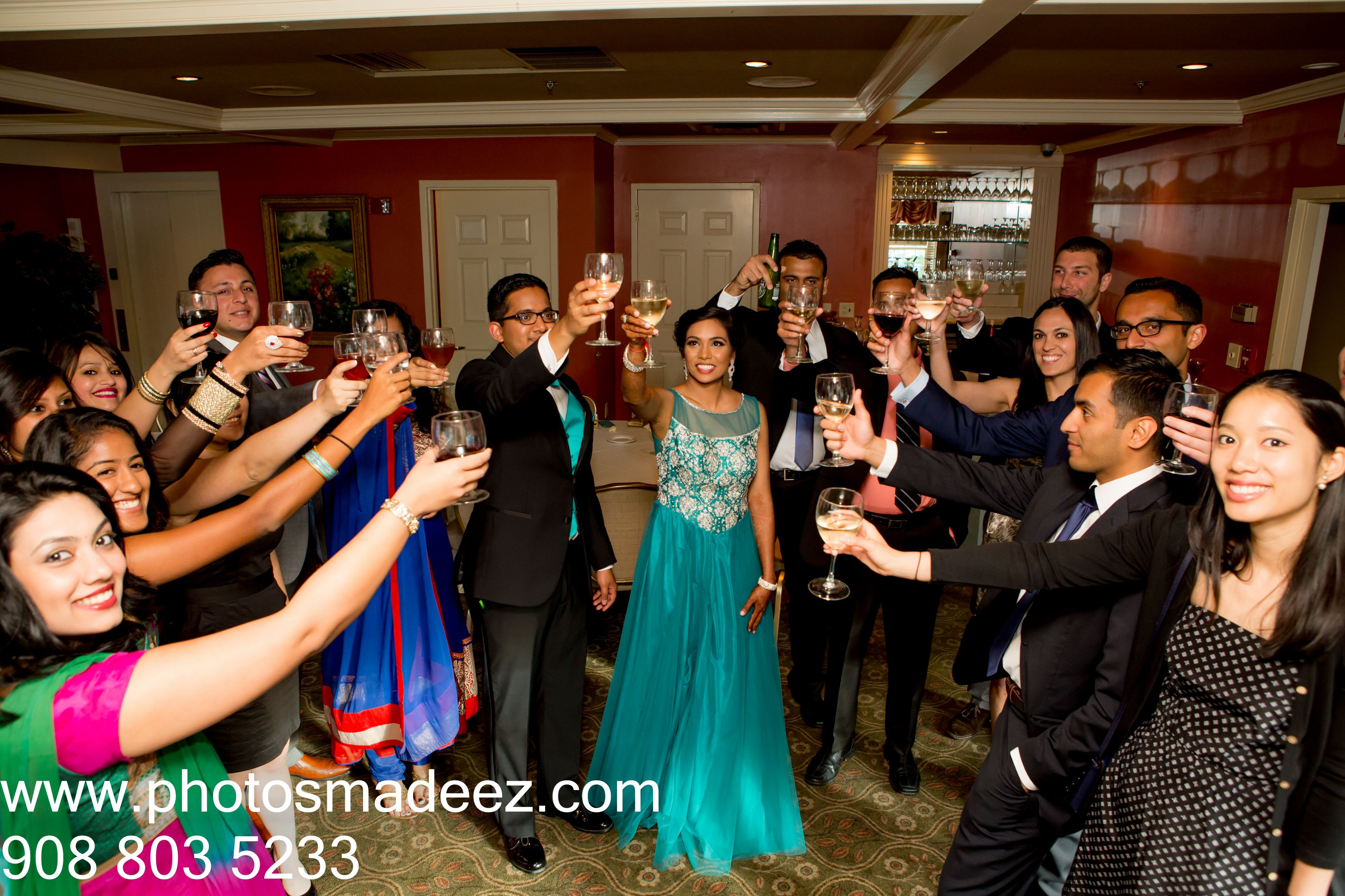 Bride and Groom toasting at Indian Wedding Reception at Springfield Country Club. Best Wedding Photographer PhotosMadeEz . Award Winning Photographer Mou Mukherjee . Bridal make up by Sanjana Vaswani, DJ Gaurav and event coodrinated by One Events Mgmt #meghahemal2015