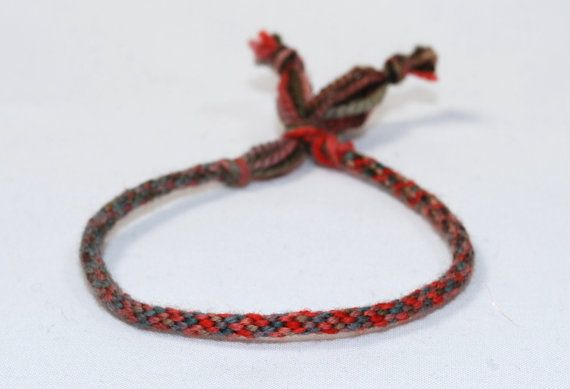 Kumihimo is an ancient Samurai braiding technique from Japan. The Samurai used it to create their armor therefore it is a strong and durable jewelry braid. This grey and pink color changing fiber bracelet has no metal (perfect for those with allergies). It is made with 100% merino wool. Now before you panic about wool let me tell you this: the bracelet is very soft and comfortable. Merino wool is some of the finest fiber in the knitting world. Each bracelet will be truly unique and one of a…