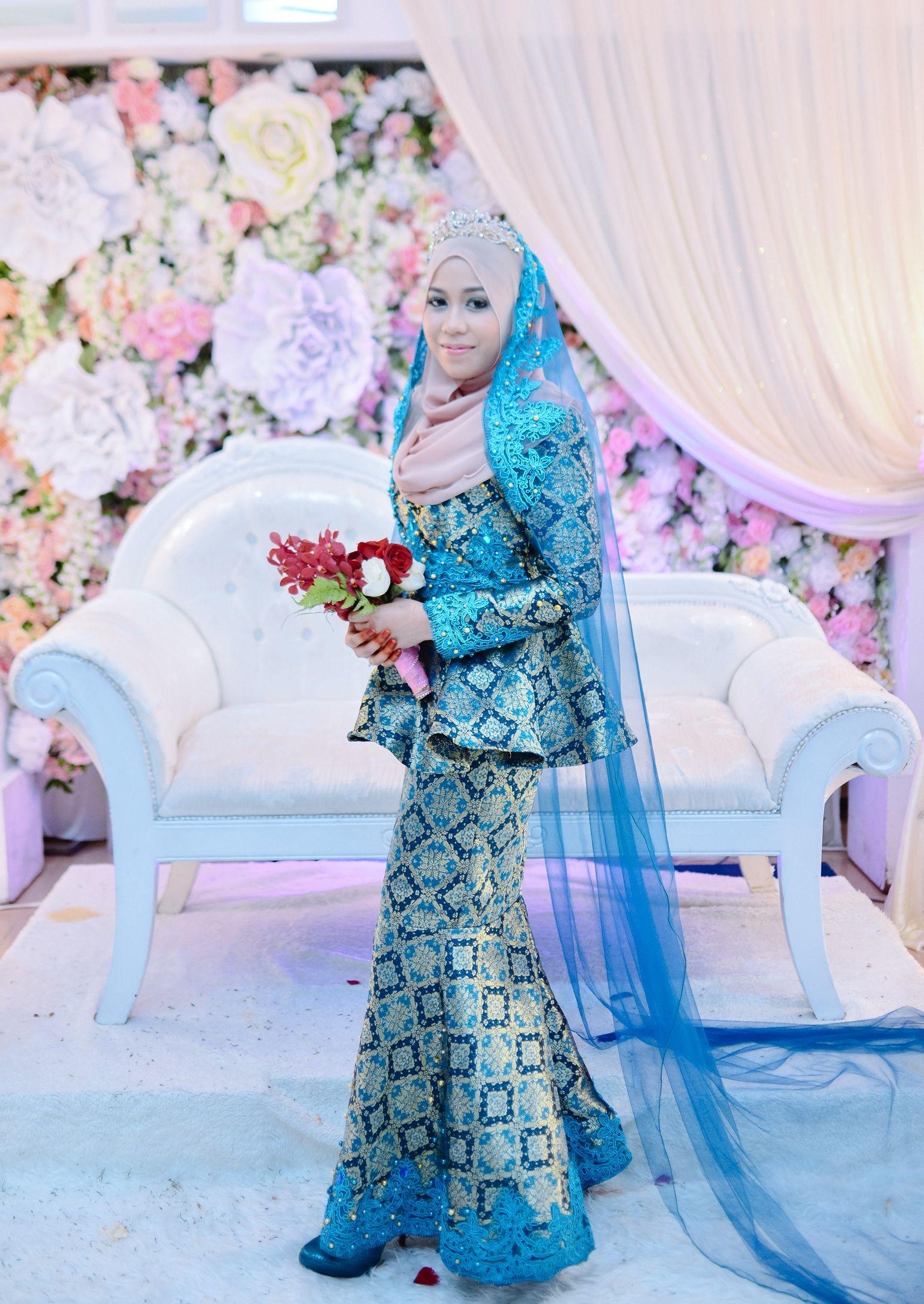 Malay songket wedding dress with simple detailings  Baju