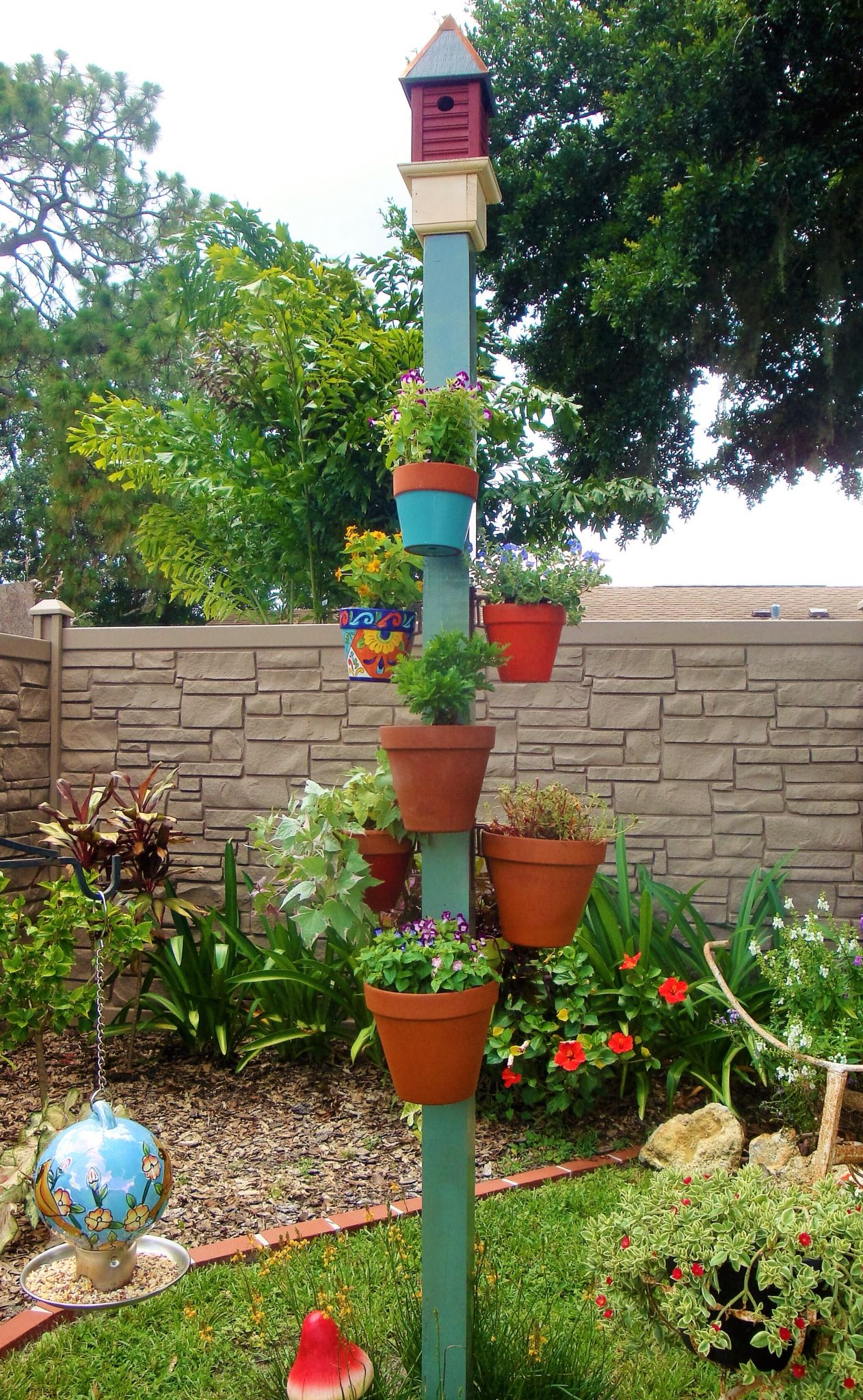 Bird House Pole With Hanging Clay Pots Secured With Hangapot Hangers Hanging Flower Pots Flower Pole Hanging Planters