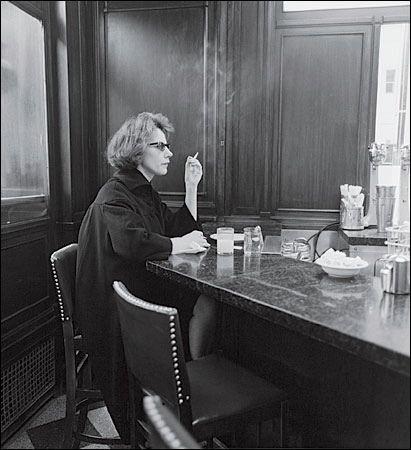 Diane Arbus - Woman at Counter Smoking N.Y.