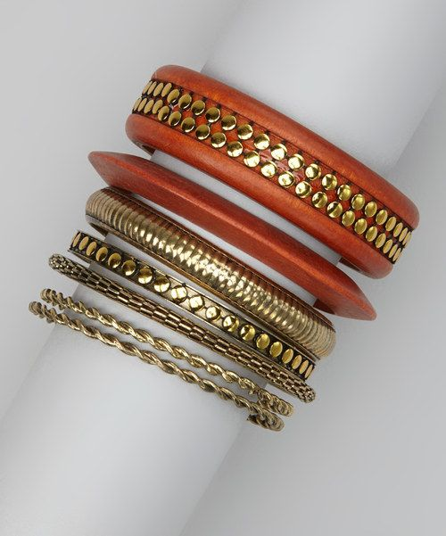Who said beauty was only skin deep? These bold bangles boast shiny studs and rich dyed wood for an eye-popping accent worth a second look.Includes 7 braceletsLargest: 1'' W x 7.5'' circumferenceAcrylic / woodImported