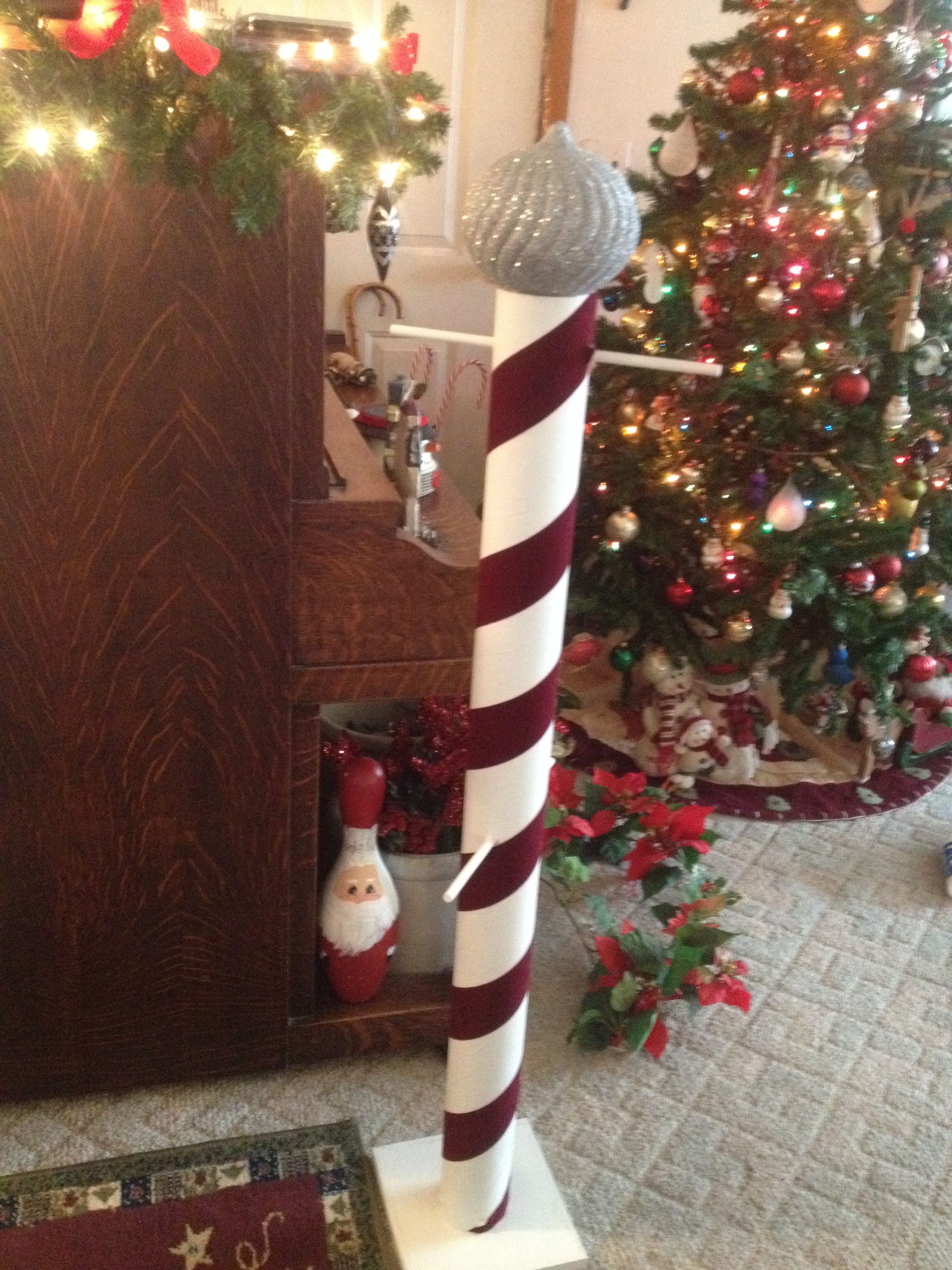 stocking tree made from cardboard tube ribbon and a large christmas ornament on top - Large Cardboard Christmas Decorations