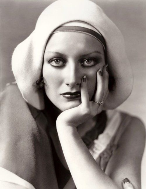 Joan Crawford in an amazing vintage 1930s hat.