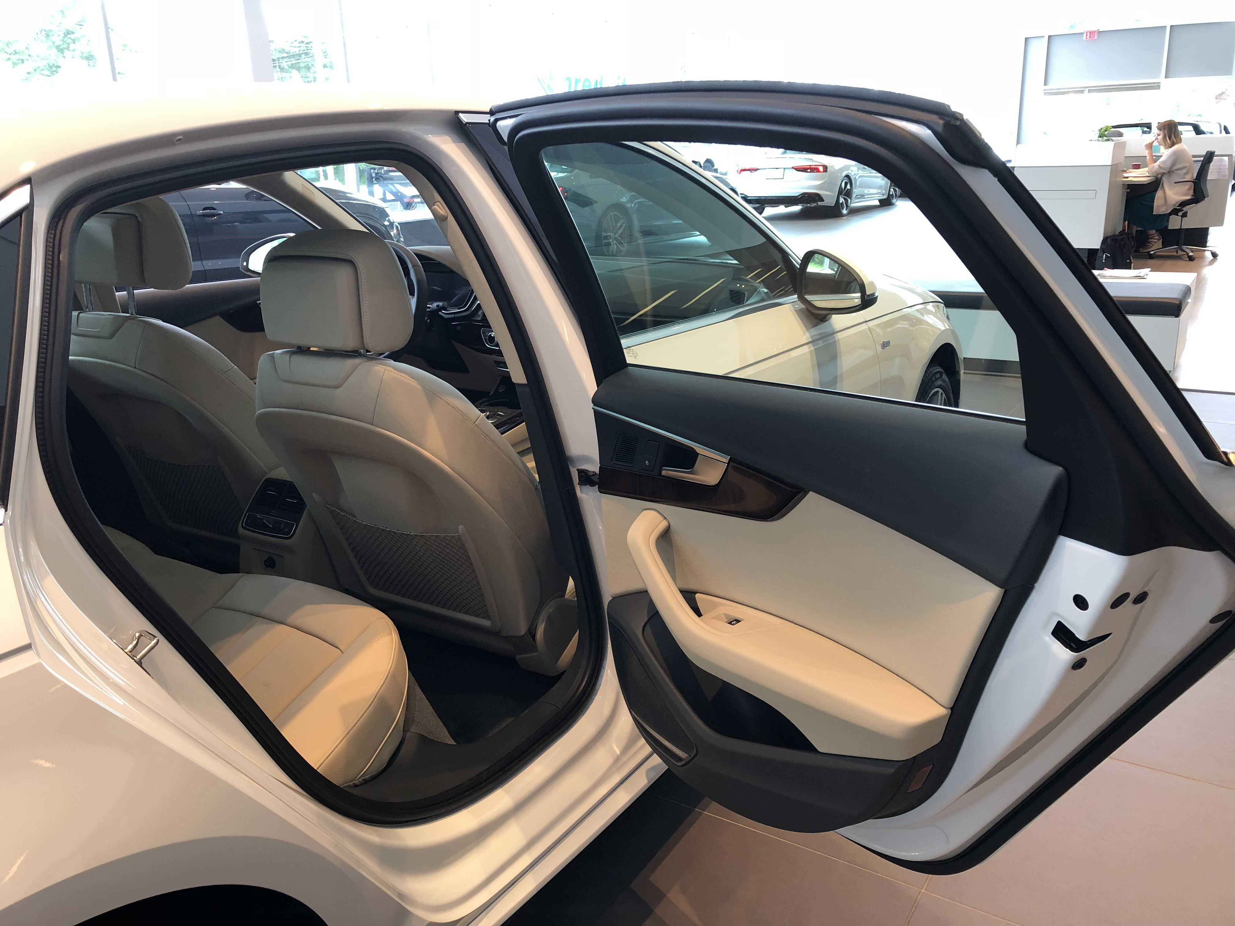 Rear Passenger Door Interior View From Door On The 2018 Audi A4 With Tan Interior With Ibis White Exterior Vehicle Locat Audi Dealership Used Luxury Cars Audi