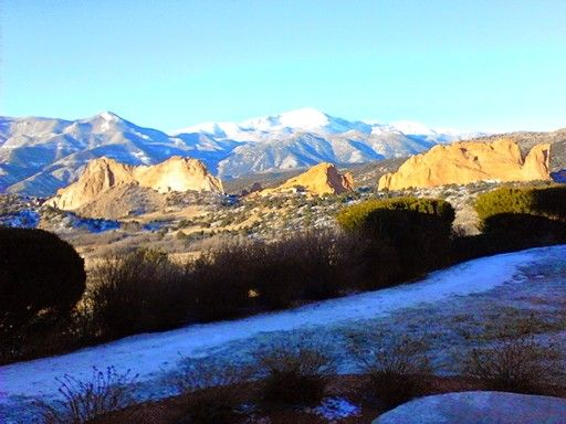 Garden of the Gods and Pikes Peak view from hotel room during retreat to plan 2015. New snow and sunrise shining on peaks.