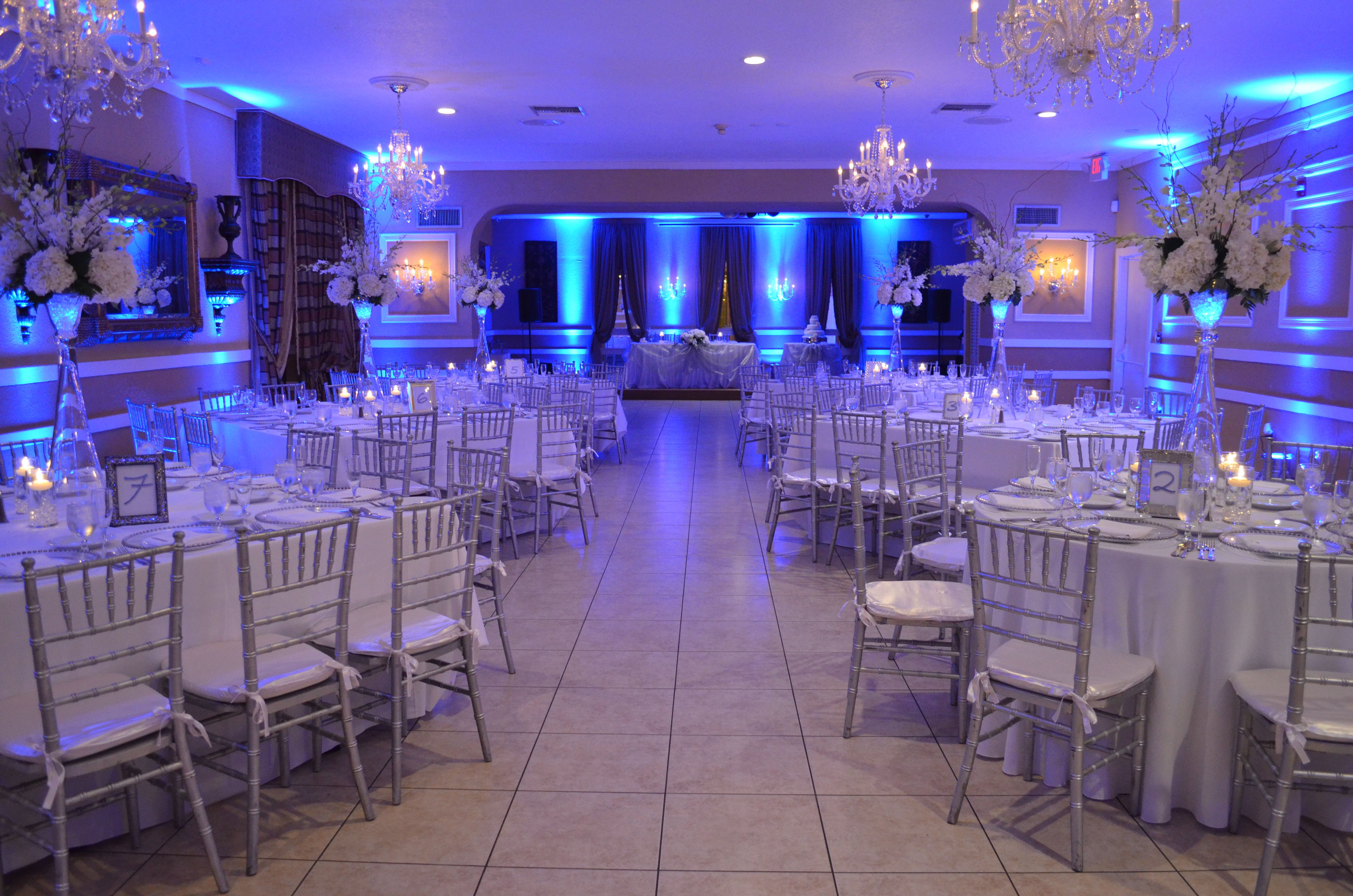 Wedding reception silver chiavari chairs and blue uplighting table