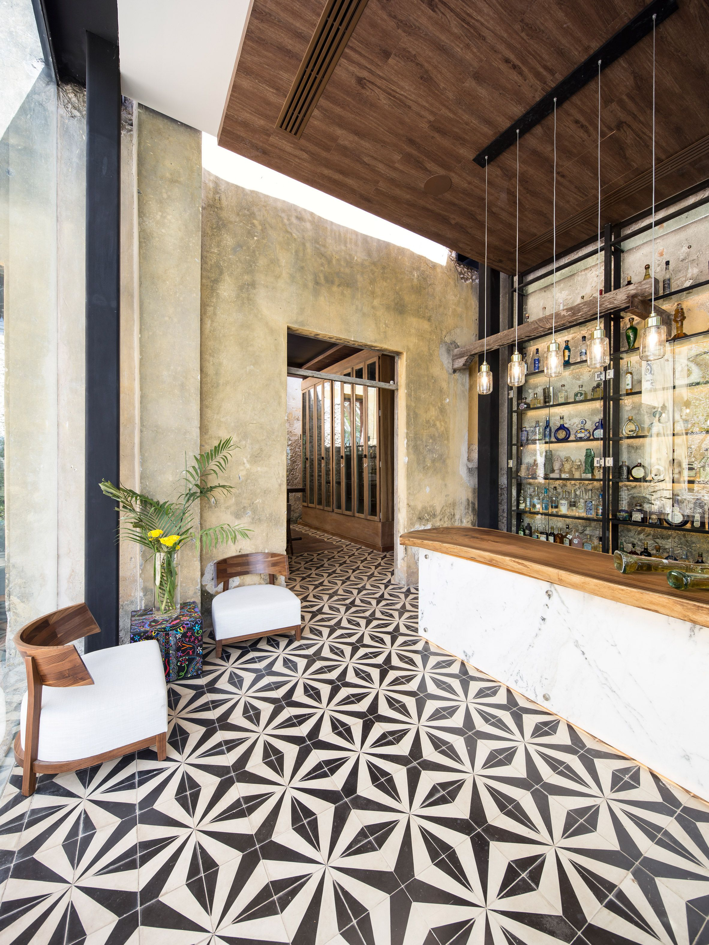 metal beams frame restaurant inserted inside old mexican textile factory