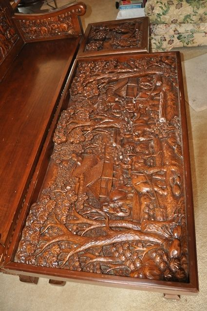This is a vintage teak wood carved sofa chair, tea/coffee table and ...