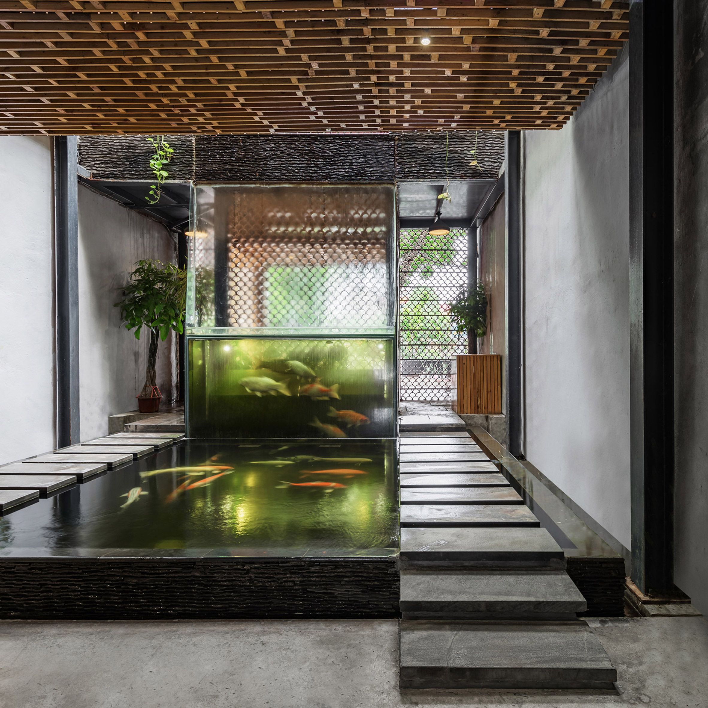 waterfall swimming featuring interior remarkable pool with nice of indoor