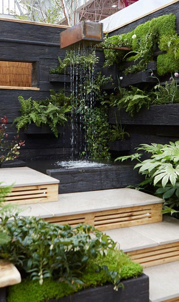 Using different levels in a small garden is a great way to make the space feel bigger. Here you step up to a water feature and then turn and step down to a sunken seating area #Gardenarchitecture