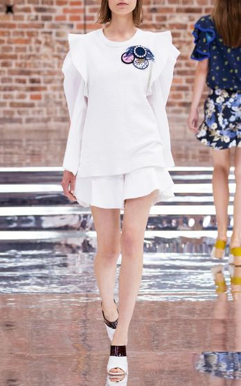 Dorothee Schumacher SS17 Summer Structure Flutter Blouse $430, Visionary Voyage Keyhole Shirt $300, Pure White Cool Attitude Ruffle Shorts $370
