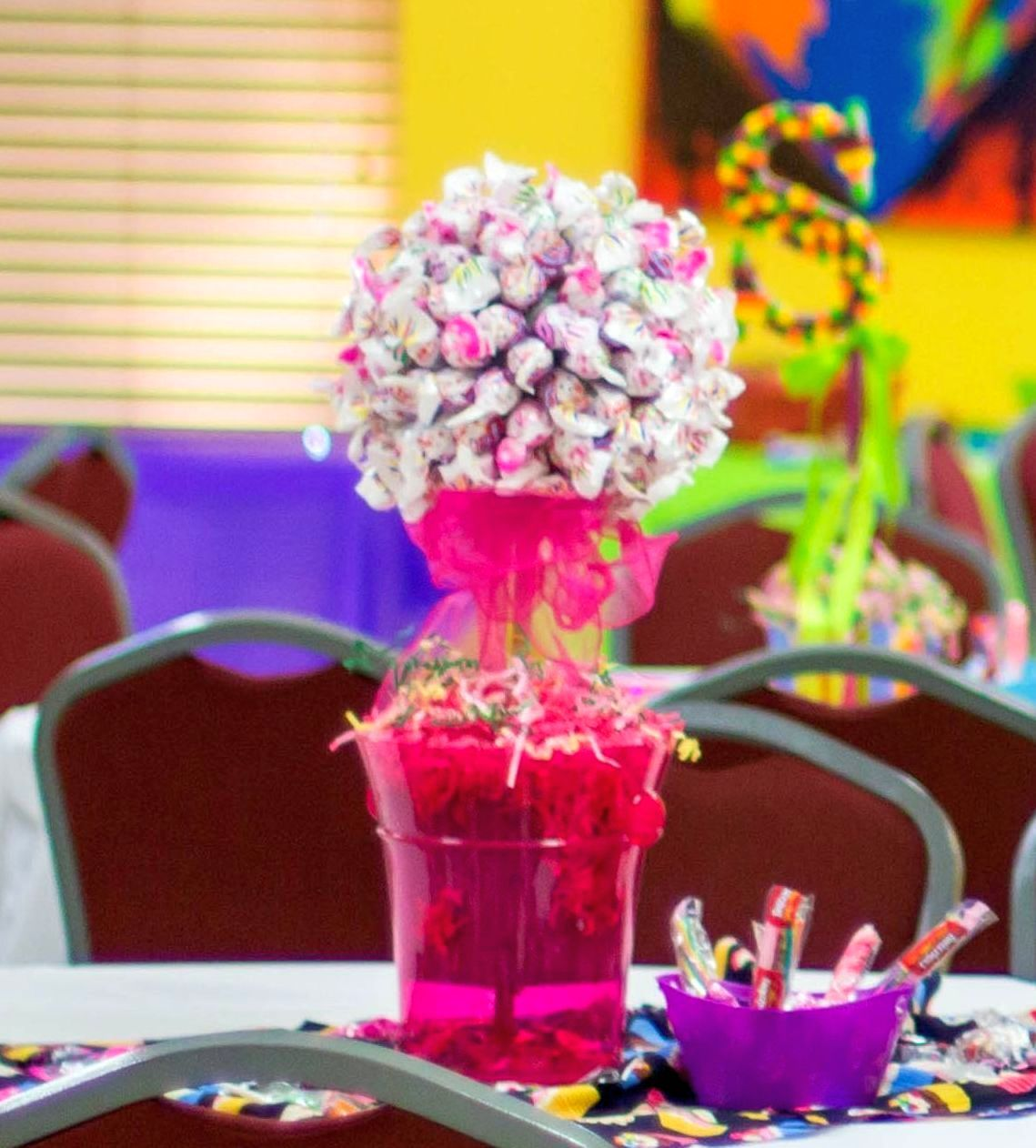 Charm tree centerpiece for a candy themed sweet sixteen
