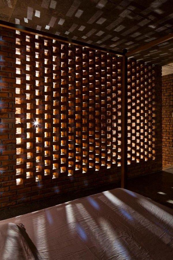 Via a creative brick house controls the interior climate and looks amazing