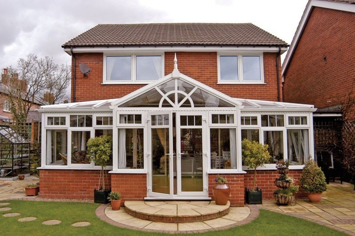 A Gable Front Conservatory Sits Beautifully In The Garden Conservatory Design Conservatory Roof Diy Conservatory