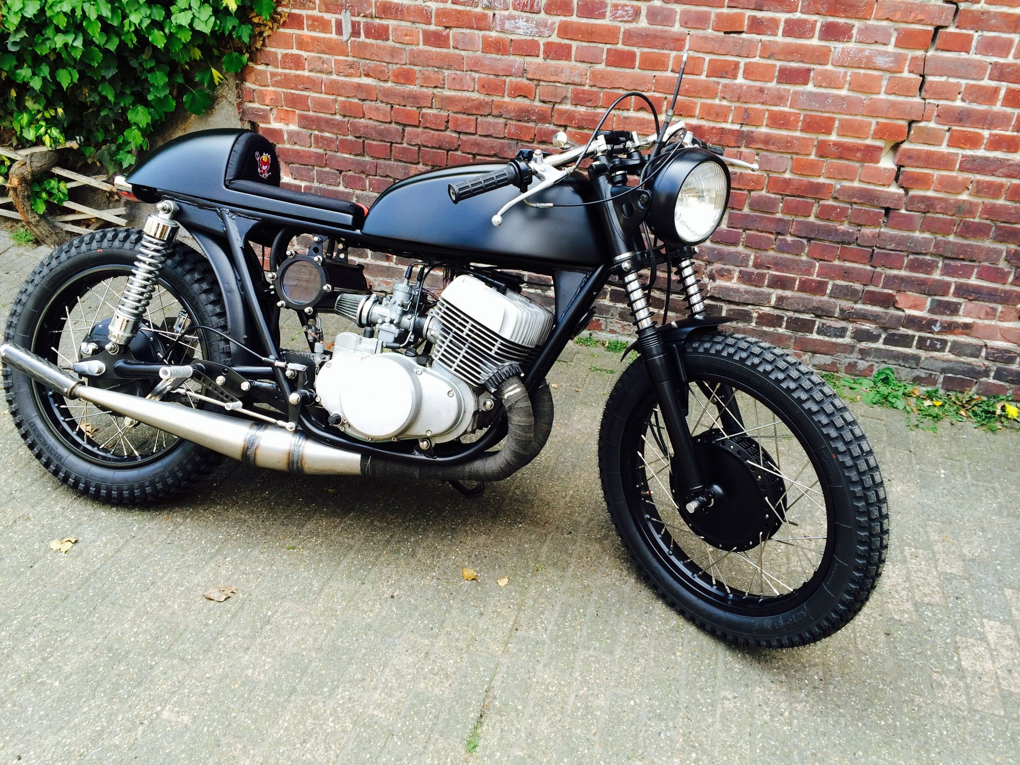 Cafe racer T500 , homebuilt exhaust,..and oil tank