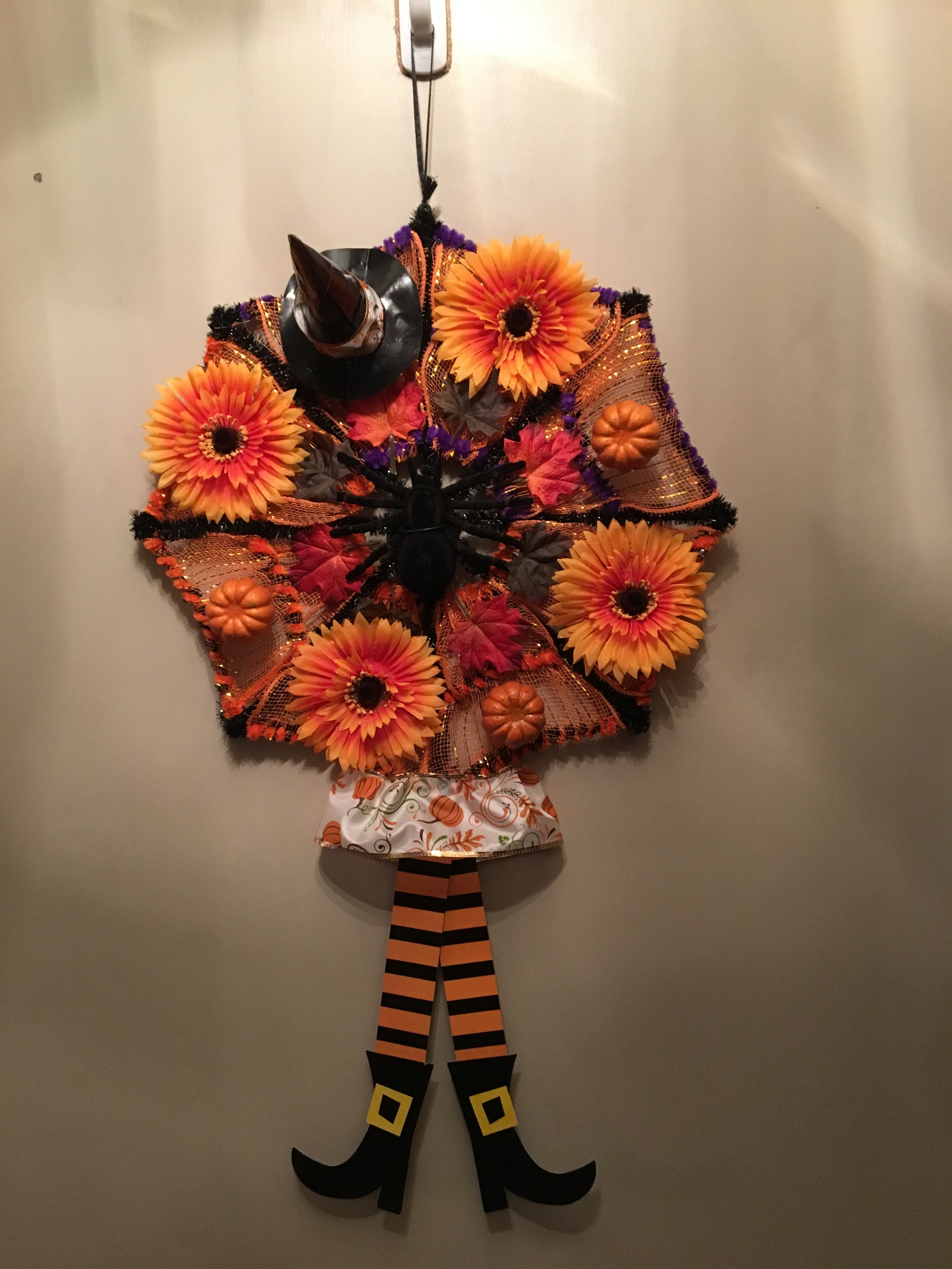 Simple and fun to make ! Supplies  web,mesh,witch legs,flowers - cool homemade halloween decorations