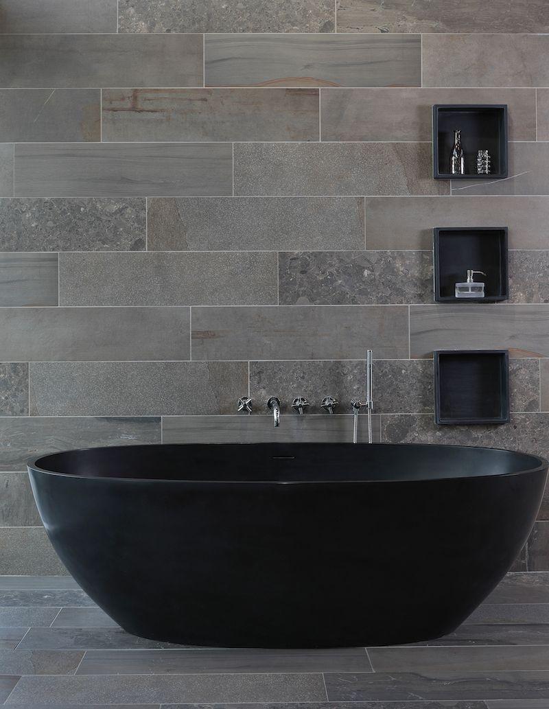 Vrijstaand bad van solid surface met een antraciet kleur ... | {Design bad 26}