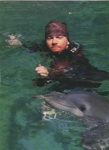 Axl with a dolphin. Behind the scenes Estranged