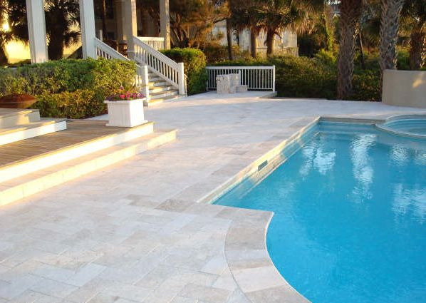 orreon tumbled coping and french pattern pavers | poolscapes
