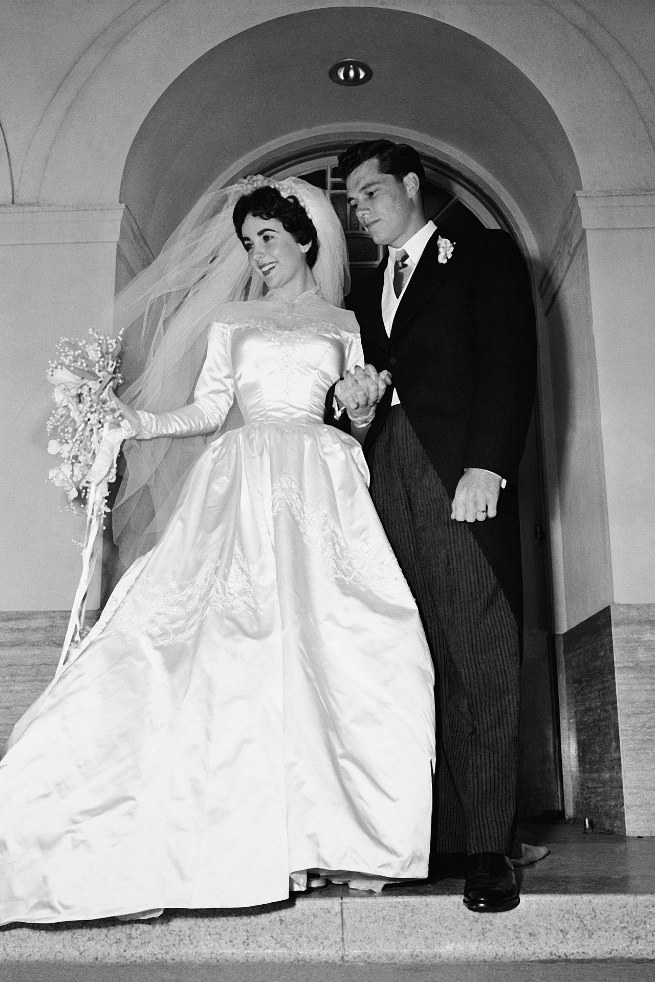 Watch Elizabeth Taylor's First Wedding Dress To Be Auctioned Off (And It Has A 22-InchWaist) video