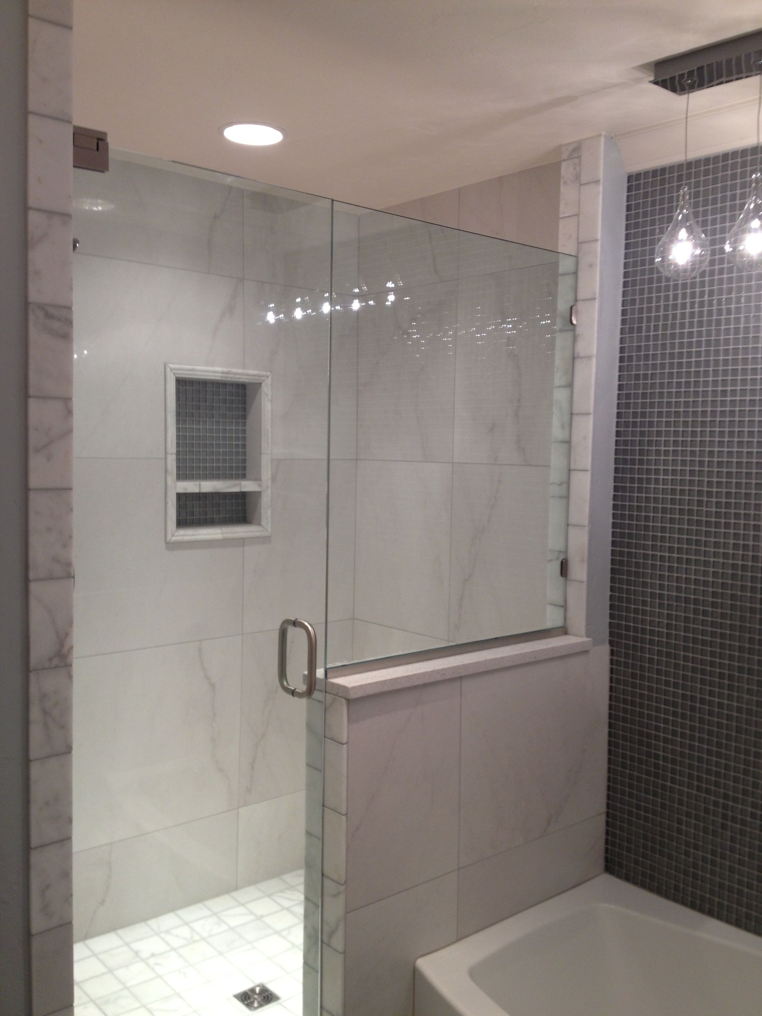 Bathroom Makeover In Hull very clean with accent glass on niche and tub wall define this